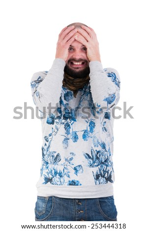 Man making a crazy desperation face by grabbing his head - stock photo
