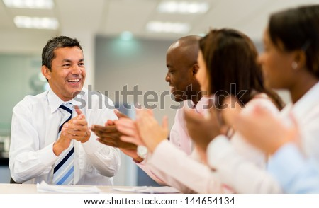 Man making a successful business presentation in a meeting - stock photo