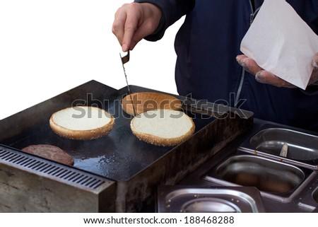 Man making and hamburger isolated on white - stock photo