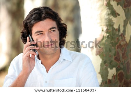 Man making call in park