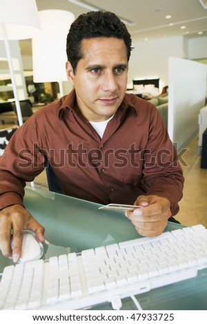 Man Making Store Purchase Through Computer - stock photo