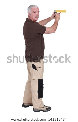 Man marking on a wall - stock photo