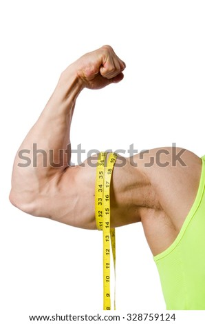 Man measuring muscles on white