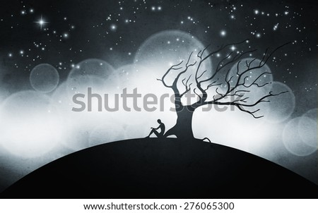 man meditating next to a tree at night silhouette illustration - stock photo