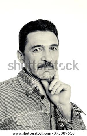 man middle aged gray mustache beard shirt  looking camera - stock photo