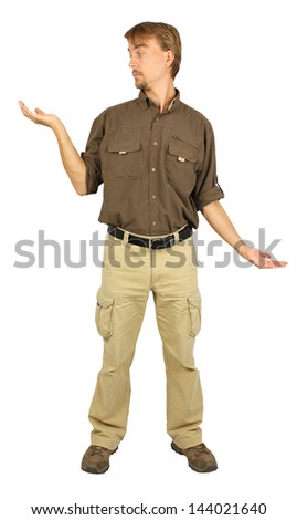 man  mimics the scales(one hand above the other below), and looks at the right hand above - stock photo