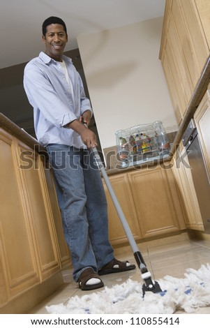 Man Mopping The Floor - stock photo
