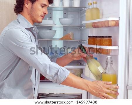 Man near Refrigerator - stock photo