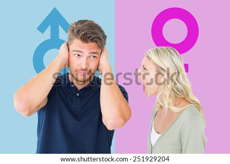 Man not listening to his shouting girlfriend against pink and blue - stock photo