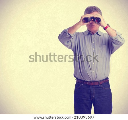 Man observing with a binoculars
