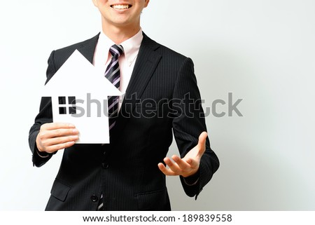 Man of Asian suit to sell a house