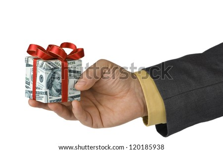 Man offering an expensive gift box wrapped in us dollar bills - stock photo