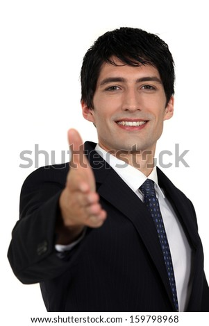 Man offering out hand - stock photo