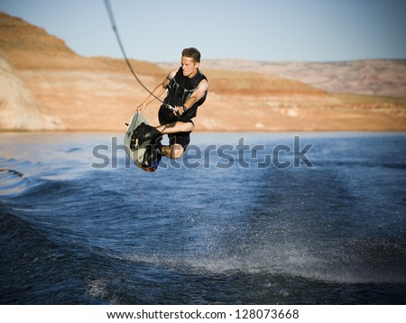 Man on a wakeboard.