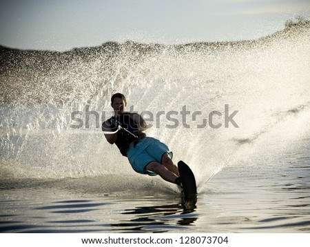 Man on a water ski. (soft focus and slight grain) - stock photo