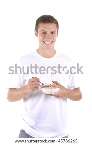 Man on a white background eating cereal. - stock photo
