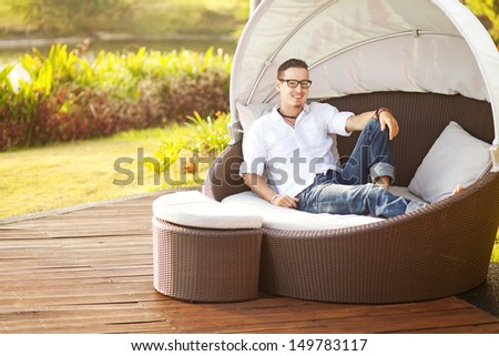 man on an outdoor bed in summer