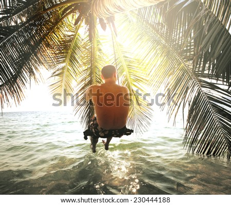 Man on beach - stock photo