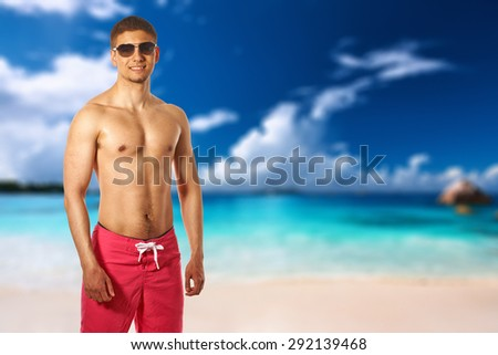 Man on beach at Seychelles, Praslin, Anse Lazio. Collage. - stock photo