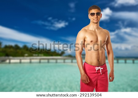 Man on beach with jetty at Maldives. Collage. - stock photo