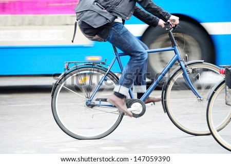 Man on bike in traffic - stock photo