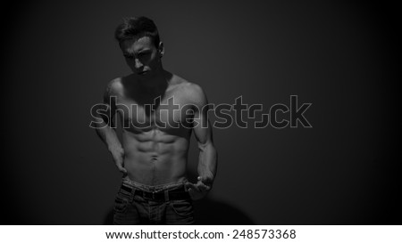 Man on black background  - stock photo