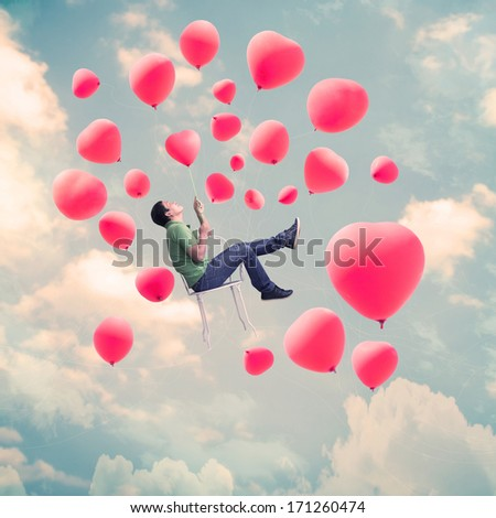 Man On Chair With Heart Balloons,Valentines Day Background - stock photo