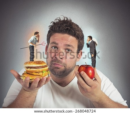 Man on diet with a guilty conscience - stock photo