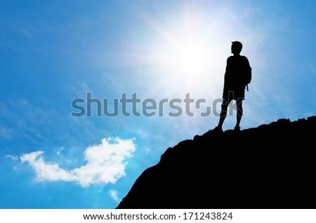Man on edge of mountain. Traveling life. - stock photo
