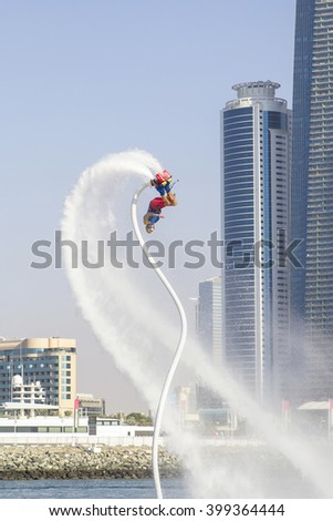 Man on flayborde doing flip jump in international competitions - stock photo