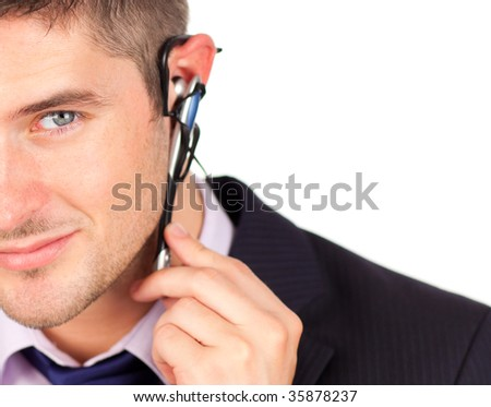 man on headset looking at the camera with copyspace - stock photo