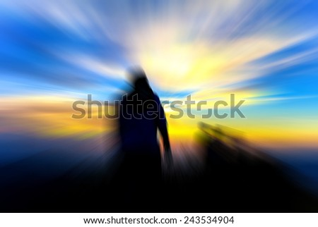man on hill evening sunset blur abstract background - stock photo