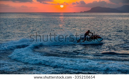 man on jetski jump on the wave - stock photo