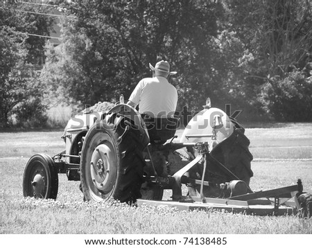 Man on mower getting ready for spring. - stock photo