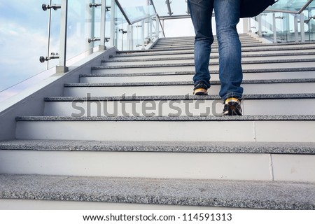 man on office stairs and blue sky
