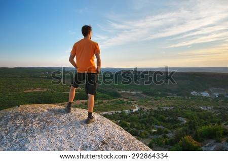 Man on peak of mountain. Element of design. - stock photo