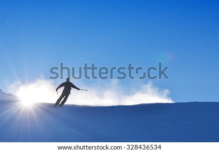Man on ski is skiing on the snow during wonderful sunny day, best for winter extreme sports - stock photo