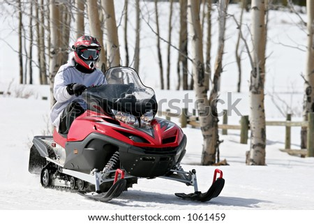 man on snowmobile in the bighorn mountains, wyoming