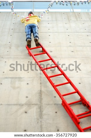 Man on stair (Fire Ladder) with decoration  - stock photo