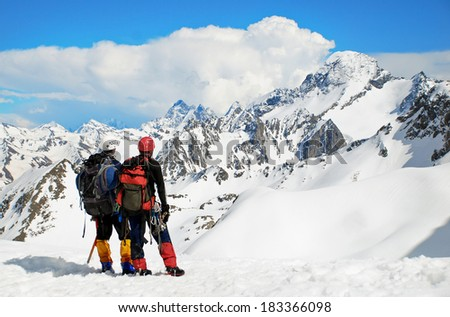 Man on summit. Hiking in the winter mountains - stock photo