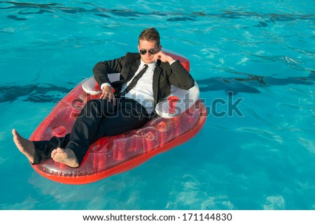 man on swimming pool - stock photo