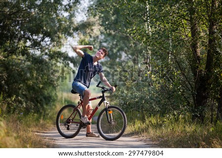 Man on the bicycle achieving new goal - stock photo