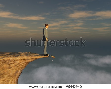 Man on the edge of a cliff - stock photo