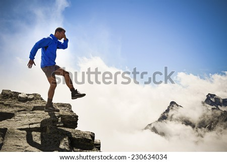 man on the edge of the abyss - stock photo