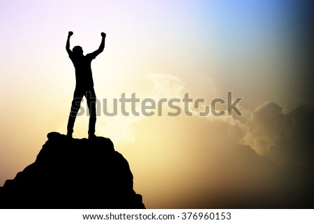 Man on the peak of mountain and sunlight  , success,winner, leader growth vision leadership spring time healthy imagination sky sport outdoor  business  friendship relationship concept
