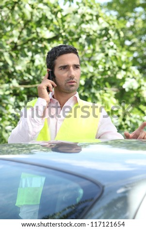 Man on the phone after a car breakdown - stock photo