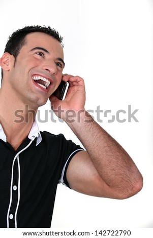 Man on the phone laughing - stock photo
