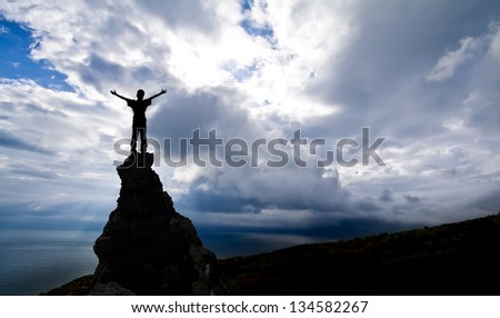 man on the top of a rock  - success concept