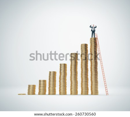 Man on the top of diagram made of coins  - stock photo