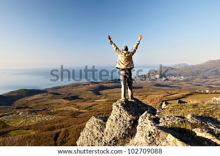 Man on the top of the mountain - stock photo